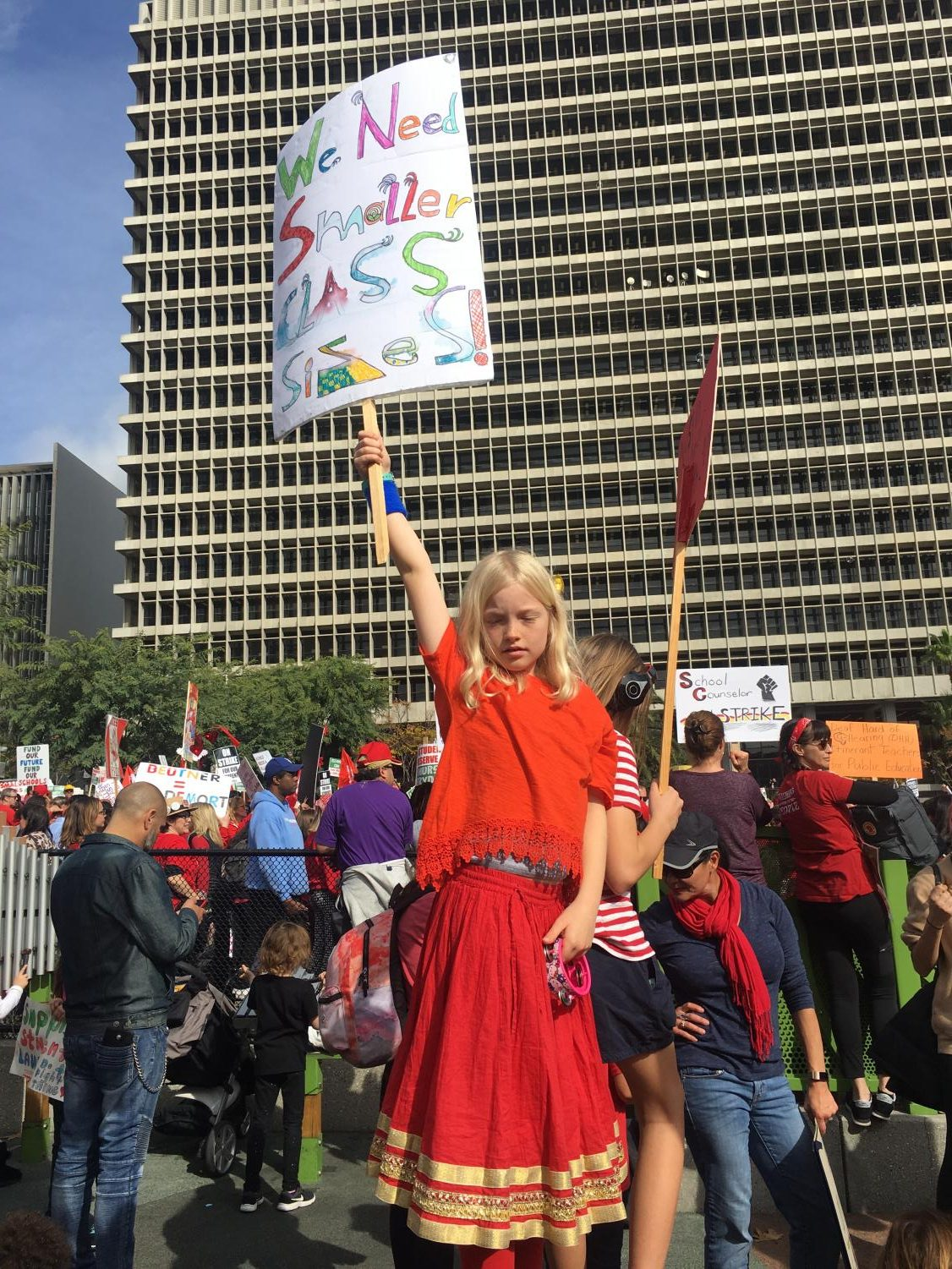 A+child+stands+tall+amidst+a+crowd+of+protesters%2C+striking+for+her%2C+and+so+many+other+children%27s+rights.+At+Bell%2C+teachers+have+had+up+to+50+kids+in+a+classroom.+%22In+the+past+I%E2%80%99ve+had+as+many+as+52+students+in+a+class...if+the+cap+is+39%2C+then+there+are+going+to+be+teachers+that+are+not+going+to+have+47%2C+not+going+to+have+50+kids+in+a+room%3B+everyone+will+have+a+chair+which+is+kind+of+important%2C%22+says+Mr.+Moreno%2C+AP+Physics+and+Environmental+Science+teacher.
