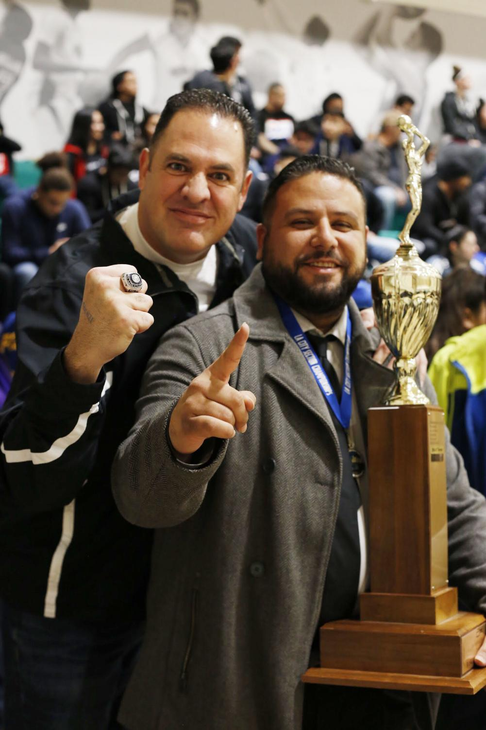 Coach+Castillo+showing+the+Championships+trophy.+