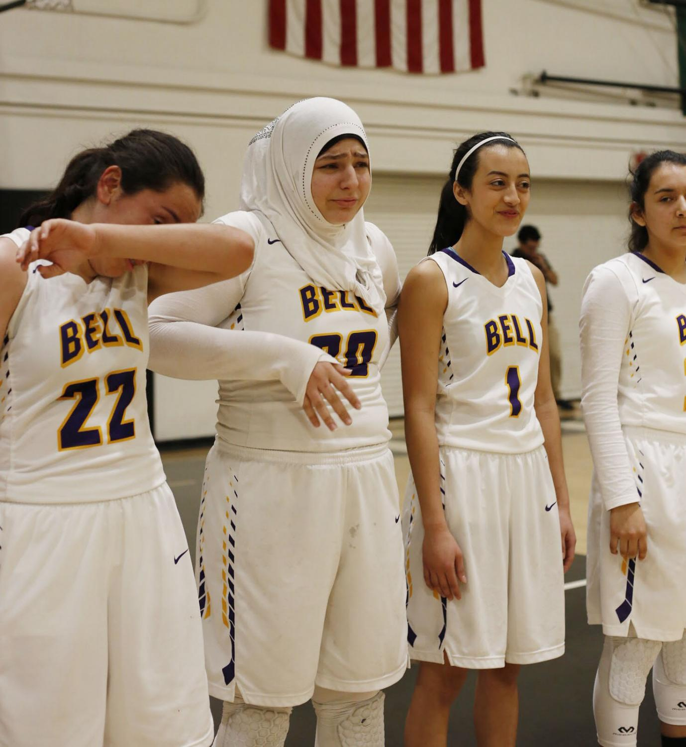 Leila+Saab+and+Brissa+Castillo+unable+to+hold+back+tears+as+they+wait+to+receive+their+medals