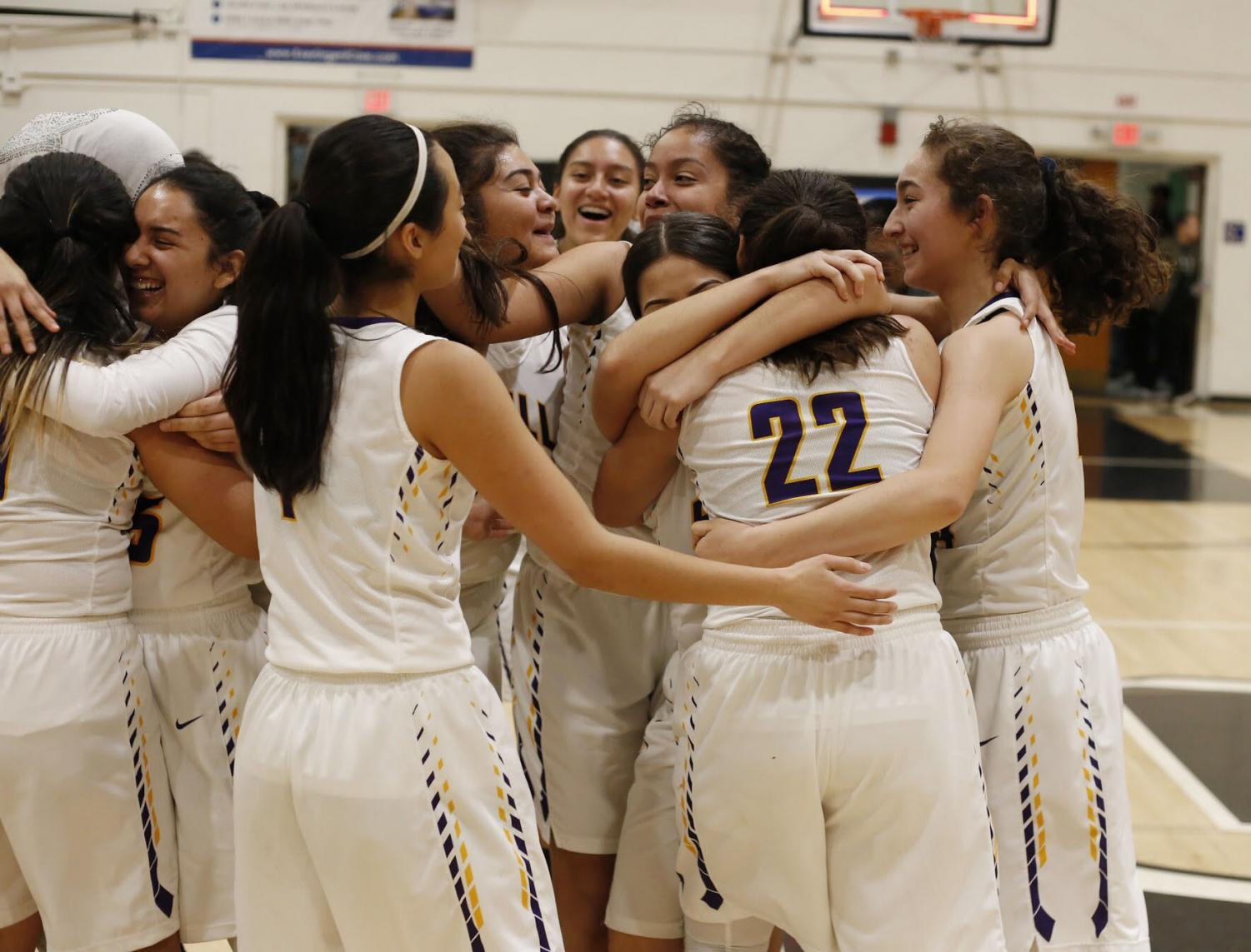 The+girls+hug+in+tight+embraces+because+they+had+just+made+history%21